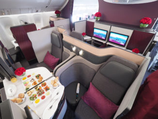 qatar malpensa suite business